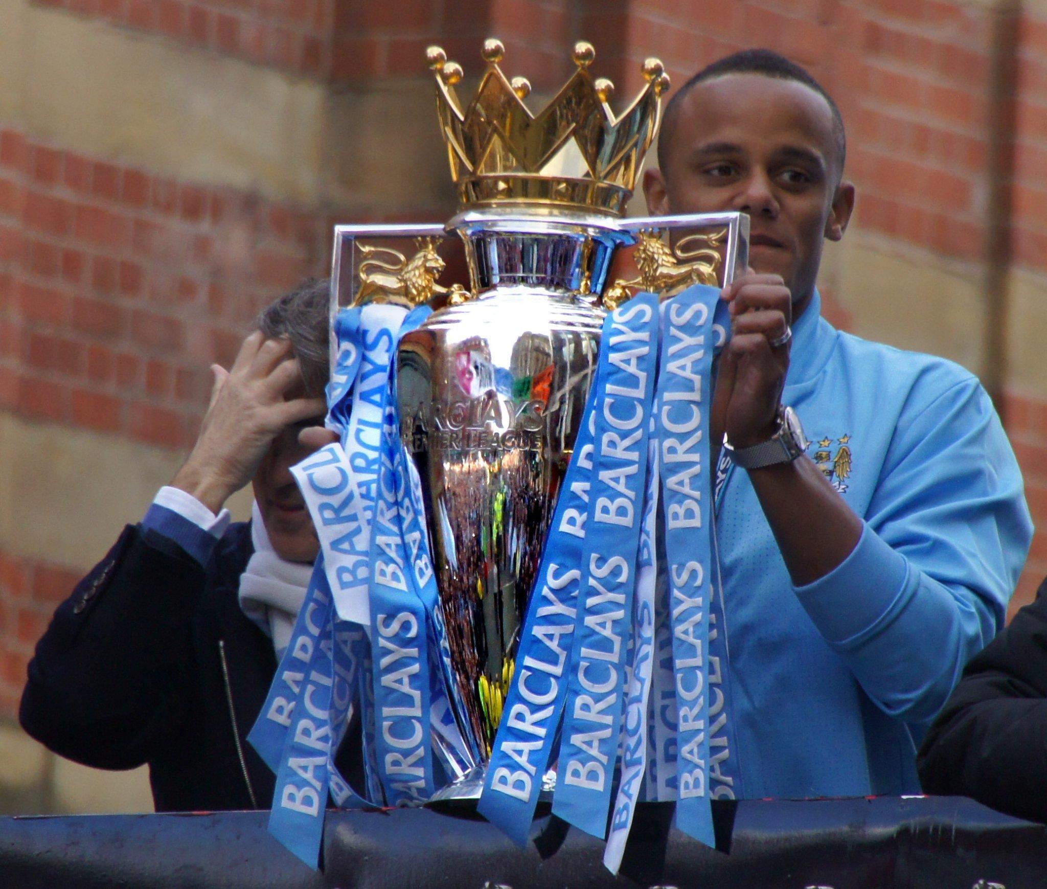 Manchester City captain Vincent Kompany with 2012 Premier League trophy